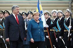 November 1, 2018 - Kyiv, Ukraine - President of Ukraine Petro Poroshenko and Chancellor of the Federal Republic of Germany Angela Merkel (L to R) review honour guards during the welcome ceremony outside the Mariinskyi Palace, Kyiv, capital of Ukraine, November 1, 2018. Ukrinform. (Credit Image: © Danil Shamkin/Ukrinform via ZUMA Wire)