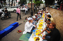 June 16, 2017 - Allahabad, Uttar Pradesh, India - Allahabad: Muslims break their fast with iftar during the holy month of Ramadan at footpath in Allahabad on june 16,2017. Muslim men and women across the world observe Ramadan, a month long celebration of self-purification and restraint. During Ramadan, the Muslim community fast, abstaining from food, drink, smoking and sex between sunrise and sunset, breaking their fast with an Iftar meal after sunset. (Credit Image: © Prabhat Kumar Verma via ZUMA Wire)