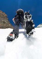 THEMENBILD - Rutschgefahr bei Schneefeldern in den Alpen. Durch Altschneefelder und mangelnder Ausruestung bei Wanderern kommt es vermehrt zu Unfaellen beim Queren von Schneefeldern. Das Bild wurde am 16. Juli 2013 waehrend einer Tour in der Granatspitzgruppe aufgenommen. im Bild Wanderer mit Steigeisen  // THEME IMAGE FEATURE - Danger of Slipping on Snowfields. The image was taken on july, 16th, 2013. Picture shows Mountaineer with Crampons walks on a Snwofield , AUT, EXPA Pictures © 2013, PhotoCredit: EXPA/ Michael Gruber
