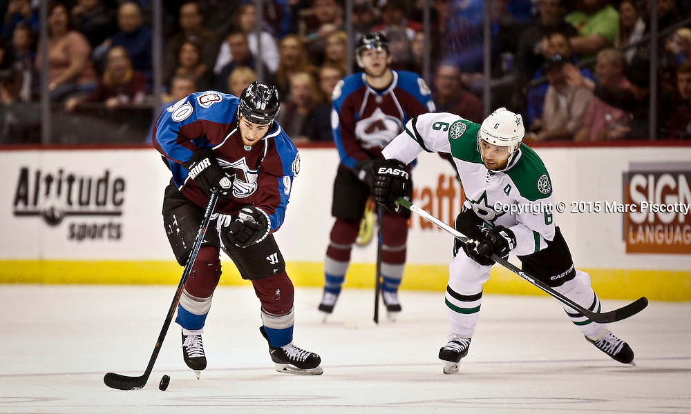 SHOT 1/10/15 4:12:00 PM - The Colorado Avalanche's Ryan O'Reilly #90 pushes the puck up ice in front of the Dallas Stars' Trevor Daley #6 during their regular season game at the Pepsi Center in Denver, Co. Colorado won the game 4-3.  (Photo by Marc Piscotty / © 2015)