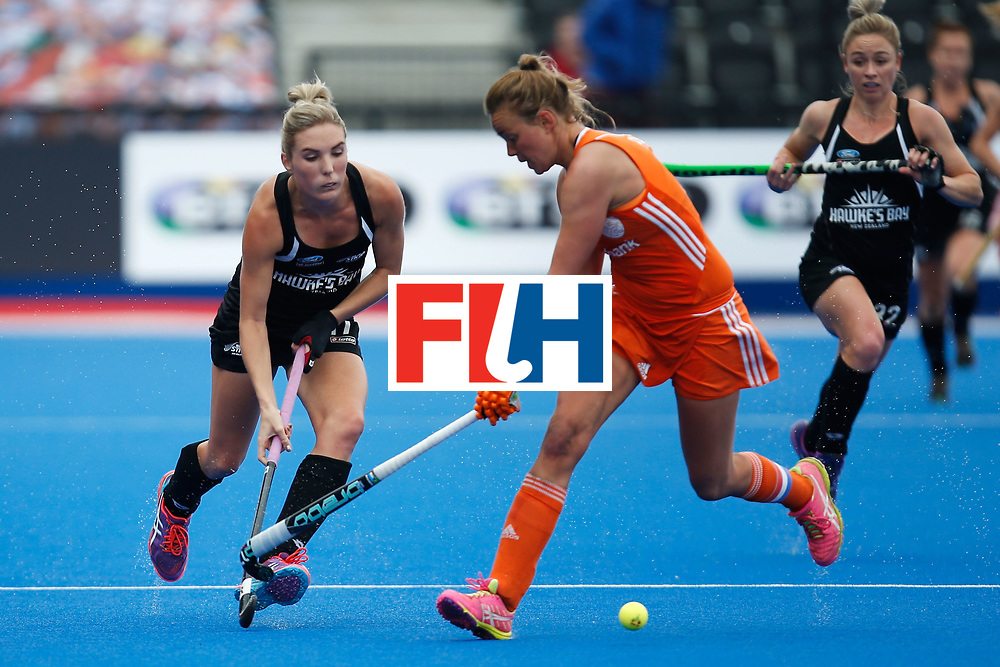 LONDON, ENGLAND - JUNE 18:  Sophie Cocks (L) of New Zealand carries the ball  during the FIH Women's Hockey Champions Trophy 2016 match between Netherlands and New Zealand at Queen Elizabeth Olympic Park on June 18, 2016 in London, England.  (Photo by Joel Ford/Getty Images)