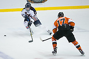 Robert Morris forward Alex Tonge tries to skate the puck past RIT forward Todd Skirving during the Atlantic Hockey final at the Blue Cross Arena in Rochester on Saturday, March 19, 2016.