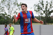 Jake Gray looks mortified at the decision not going Palace's way during the U21 Professional Development League match between Crystal Palace U21s and Huddersfield U21s at Imperial Fields, Tooting, United Kingdom on 7 September 2015. Photo by Michael Hulf.