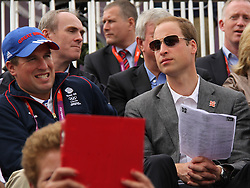 © licensed to London News Pictures. London, UK. 01/08/2012. Prince William watching Zara Phillips compete at Olympic Equestrian Showjumping at Greenwich Park on August 1, 2012. Photo credit: Russell Marsh/LNP