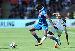 Nathan Dyer of Swansea City competes with Papa Alioune Ndiaye of Stoke City - Mandatory by-line: Nizaam Jones/JMP- 13/05/2018 - FOOTBALL - Liberty Stadium - Swansea, Wales - Swansea City v Stoke City - Premier League