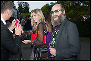 DONNA AIR; GAVIN TURK, 2014 Serpentine's summer party sponsored by Brioni.with a pavilion designed this year by Chilean architect Smiljan Radic  Kensington Gdns. London. 1July 2014