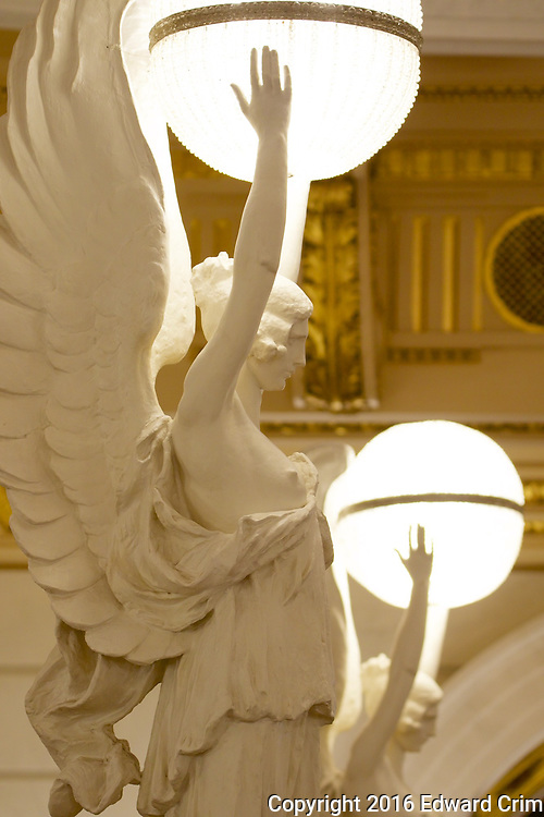 Angels of light on the newell posts at the bottom of the grand stair in the rotunda of the Pennsylvania capitol in Harrisburg.