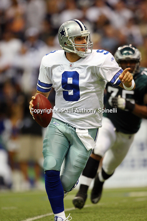 IRVING, TX - SEPTEMBER 15:  Quarterback Tony Romo #9 of the Dallas Cowboys points as he rolls to his right while looking downfield for a receiver during the game against the Philadelphia Eagles at Texas Stadium on September 15, 2008 in Irving, Texas. The Cowboys defeated the Eagles 41-37. ©Paul Anthony Spinelli *** Local Caption *** Tony Romo