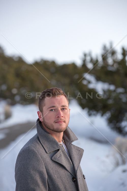 portrait of a man outdoors in a peacoat