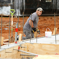 THOMAS WELLS | BUY at PHOTOS.DJOURNAL.COM<br /> Anthony Shettles of Hooker Construction helps removes the wood for the concrete forms for the new storm shelter that is under construction at North Pontotoc High School on Monday.