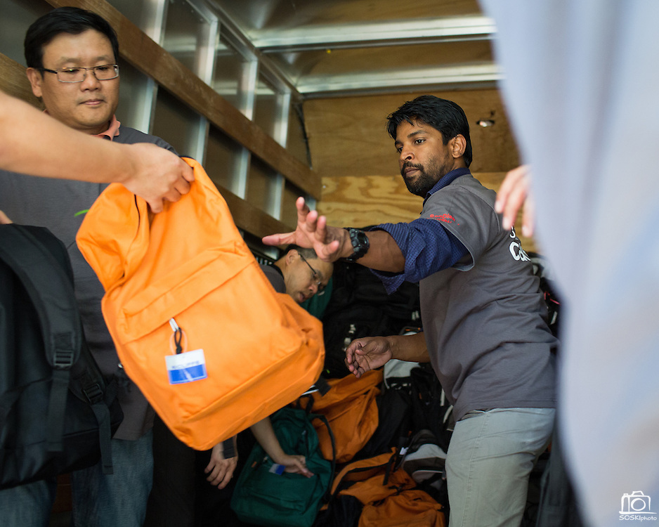 Saravanan Kalinagasamy of SanDisk helps load backpacks into a truck during a backpack drive for Family Giving Tree at the SanDisk headquarters in Milpitas, California, on August 15, 2013. (Stan Olszewski/SOSKIphoto)