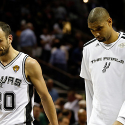 Jun 13, 2013; San Antonio, TX, USA; San Antonio Spurs shooting guard Manu Ginobili (20) and power forward Tim Duncan (right) walk off the court after game four of the 2013 NBA Finals against the San Antonio Spurs at the AT&T Center. The Miami Heat defeated the San Antonio Spurs 109-93. Mandatory Credit: Derick E. Hingle-USA TODAY Sports