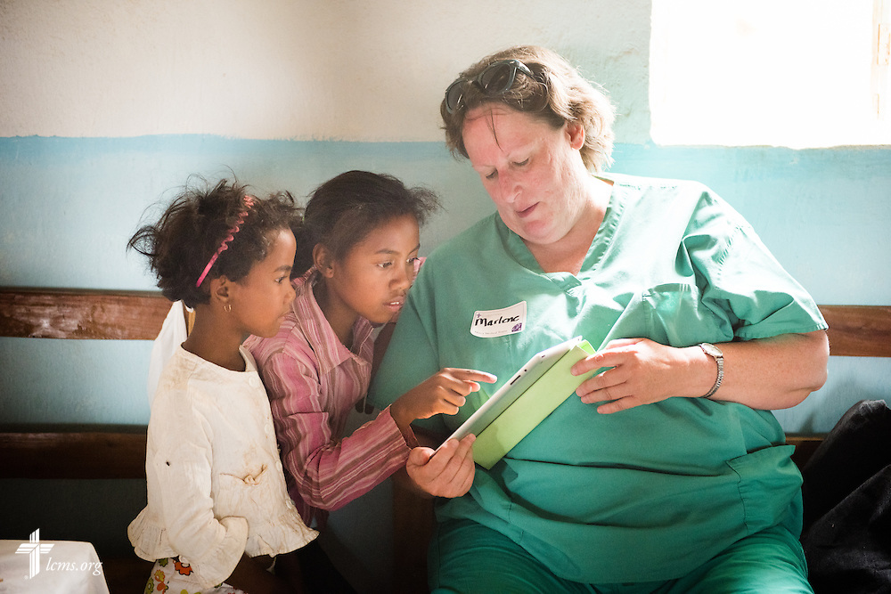 Marlene Soares works with children as she treats patients with the Mercy Medical Team on Saturday, Oct. 18, 2014, at a Fiangonana Loterana Malagasy (FLM) Lutheran church in Antsoantany, Madagascar. LCMS Communications/Erik M. Lunsford