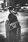 A man on a street corner standing with his ghetto blaster, Downtown San Francisco, USA, 1980.