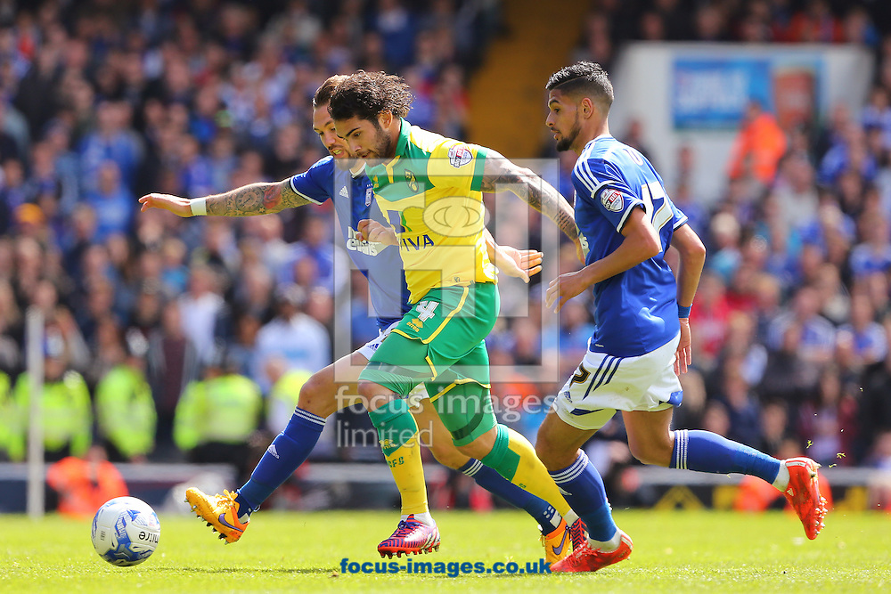 Bradley Johnson of Norwich City gets between Luke Chambers (left) and Kevin Bru (right) of Ipswich Town during the Sky Bet Championship play off semi final first leg at Portman Road, Ipswich<br /> Picture by Richard Calver/Focus Images Ltd +44 7792 981244<br /> 09/05/2015