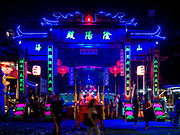 25 AUGUST 2018 - GEORGE TOWN, PENANG, MALAYSIA: A shrine built for the Hungry Ghost festival on the Lim Jetty on Ghost Day, the full moon day (or night) that falls in the middle of Hungry Ghost month. The Lim Jetty is one of several jetties in George Town that were created by members of Chinese clans who migrated to Penang during the British colonial period. The Ghost Festival, also known as the Hungry Ghost Festival is a traditional Taoist and Buddhist festival held in Chinese communities throughout Asia. Ghost Day, is on the 15th night of the seventh month (25 August in 2018). During Ghost Festival, the deceased are believed to visit the living. In many Chinese communities, there are Chinese operas and puppet shows and elaborate banquets are staged to appease the ghosts.      PHOTO BY JACK KURTZ