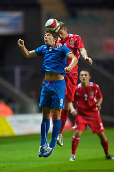 SWANSEA, ENGLAND - Friday, September 4, 2009: Wales' Andy King and Italy's Alberto Paloschi during the UEFA Under 21 Championship Qualifying Group 3 match at the Liberty Stadium. (Photo by David Rawcliffe/Propaganda)