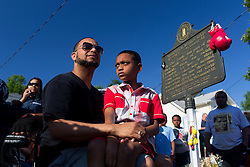 Charles Kirtley, left, and his son Malachi, 10 of Covington wait for the funeral procession for boxing legend Muhammad Ali, a Louisville native, to stop by his childhood home on Grand Avenue, Friday, June 10, 2016 at Muhammad Ali Funeral Procession in Louisville.