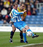 Photo: Scott Heavey.<br />Oxford United v Huddersfeild Town. Nationide Division Three. 06/03/2004.<br />Andy Booth of Huddersfield keeps the ball in play under pressure from Matt Bound