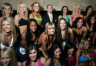 James Trieb (C) is surrounded by newly-named Denver Broncos cheerleaders after the cheerleader finals in Denver, Colorado April 1, 2007. Trieb won an NFL auction to be a guest judge for the cheerleader tryouts paying $1,750 for the opportunity. REUTERS/Rick Wilking (UNITED STATES)