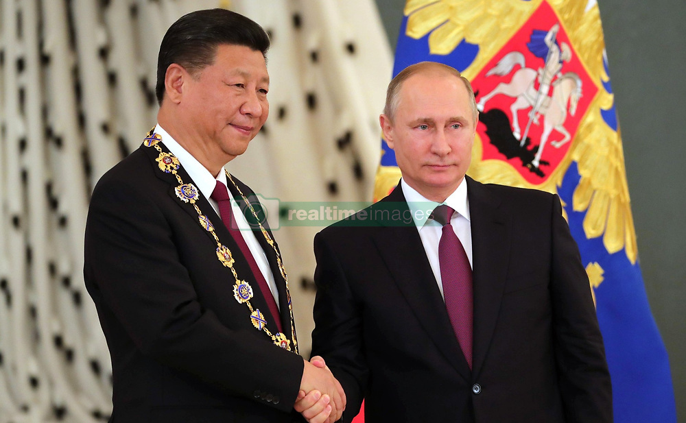 July 4, 2017 - Moscow, Russia - July 4, 2017. - Russia, Moscow. - From right: Russian President Vladimir Putin meets with People's Republic of China President Xi Jinping who has been awarded the Order of Saint Apostle Andrew the First-Called in Moscow. (Credit Image: © Russian Look via ZUMA Wire)