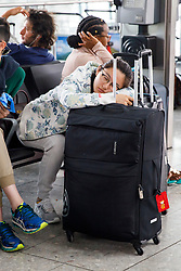 © Licensed to London News Pictures. 29/05/2017. London, UK. A passenger napping whilst waiting for her flight on bank holiday Monday after a major British Airways IT crash causing further problems in Heathrow Terminal 5 since Saturday. Photo credit: Tolga Akmen/LNP