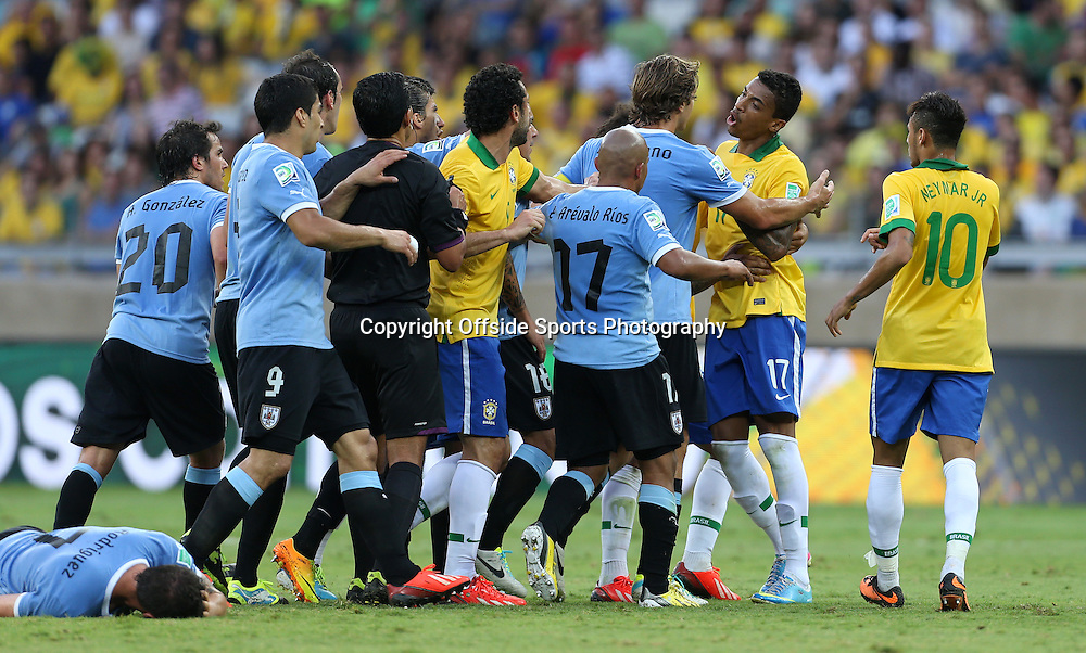 26th June 2013 - FIFA Confederations Cup 2013 (Semi-Final) - Brazil v Uruguay - Tempers flare after a foul from Luiz Gustavo of Brazil (2R) - Photo: Simon Stacpoole / Offside.