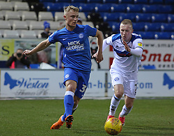 Kyle Dempsey of Peterborough United in action with Stephen Dooley of Rochdale- Mandatory by-line: Joe Dent/JMP - 12/01/2019 - FOOTBALL - ABAX Stadium - Peterborough, England - Peterborough United v Rochdale - Sky Bet League One