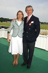 ARNAUD & CARLA BAMBERGER at the Queen's Cup polo final sponsored by Cartier at Guards Polo Club, Smith's Lawn, Windsor Great Park on 18th June 2006.  The Final was between Dubai and the Broncos polo teams with Dubai winning.<br />