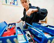 Plumber Pauline Brown in a flat conversion..Pauline Brown lies across the floor in a converted Hackney council flat bathroom.. tools, training, UK, water, women, women, work, work. .
