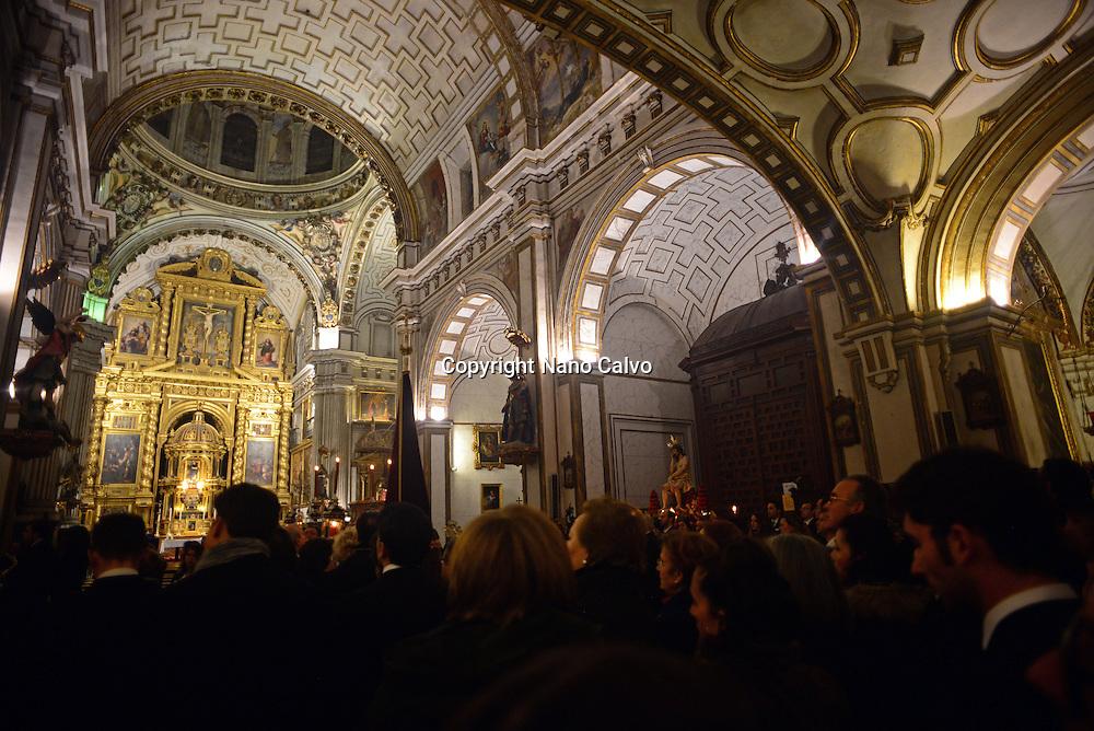 Holy week procession enters Colegiata de San Justo y Pastor in Granada, Spain