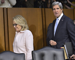 U.S. Secretary of State Hillary Clinton (L) hugs Senator John Kerry during his confirmation hearing before the Senate Foreign Relations Committee to become the next Secretary of State on Capitol Hill, in Washington D.C., capital of the United States, January 24, 2013. Photo by Imago / i-Images...UK ONLY