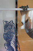 Natural sculpture based on tree bark and dyed using indigo, by fabric artist Betty de Paris, in her studio at Cite Aubry, in the 20th arrondissement of Paris, France. The Japanese indigo vat is a traditional dyeing technique using indigo leaf compost, a vegetal process involving no chemicals. Betty de Paris learned her art of traditional stencil dyeing and finishing from a master in Kyoto, Japan. Working as an artist, designer, consultant and Japanese interpreter, she has participated in numerous museum projects and workshops, regularly exhibits her work and speaks at international conferences. Picture by Manuel Cohen