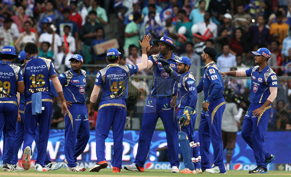 Mumbai Indians players celebrates the wicket of Sunrisers Hyderabad player Naman Ojha during match 23 of the Pepsi IPL 2015 (Indian Premier League) between The Mumbai Indians and The Sunrisers Hyderabad held at the Wankhede Stadium in Mumbai India on the 25th April 2015.<br /> <br /> Photo by:  Vipin Pawar / SPORTZPICS / IPL