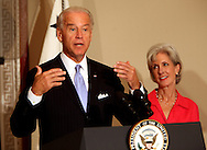 Vice President Joseph Biden and HHS Kathleen Sebelius at a roundtable discussion on the rising costs of health care for people who work in small businesses  and small business employers.  The discuss was held in the Old Executive Office Building on July 10, 2009.  Photograph by Dennis Brack