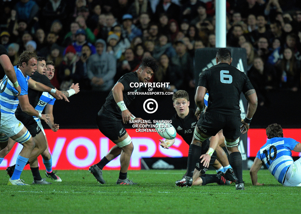 Beauden Barrett passes to Jerome Kaino during The Rugby Championship match between the NZ All Blacks and Argentina Pumas at FMG Stadium in Hamilton, New Zealand on Saturday, 10 September 2016. Photo: Dave Lintott / lintottphoto.co.nz