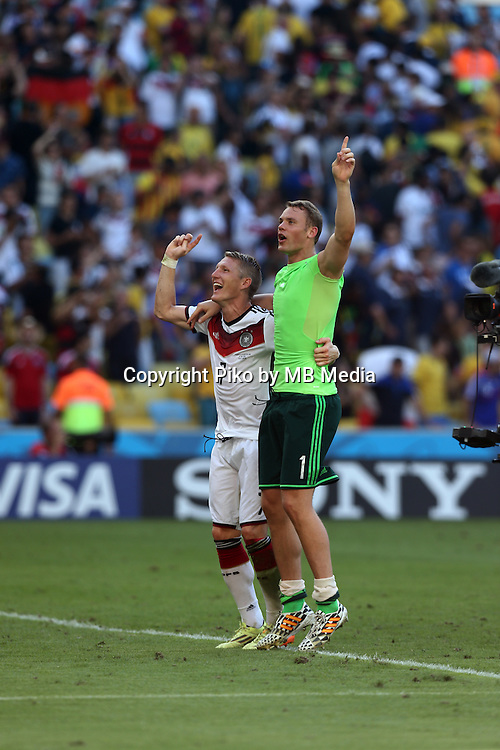 Fifa Soccer World Cup - Brazil 2014 - <br /> FRANCE (FRA) Vs. GERMANY (GER) - Quarter-finals - Estadio do MaracanaRio De Janeiro -- Brazil (BRA) - 04 July 2014 <br /> Here German players Bastian SCHWEINSTEIGER (L) and GK Manuel NEUER (R)  celebrating after finish the match.<br /> &copy; PikoPress
