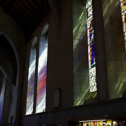 The beautiful stain glass windows casts colours in Christ Church Cathedral, the Anglican cathedral in Nelson. The cathedral is located at upper Trafalgar Street. Nelson,  New Zealand,1st February 2010. Photo Tim Clayton.