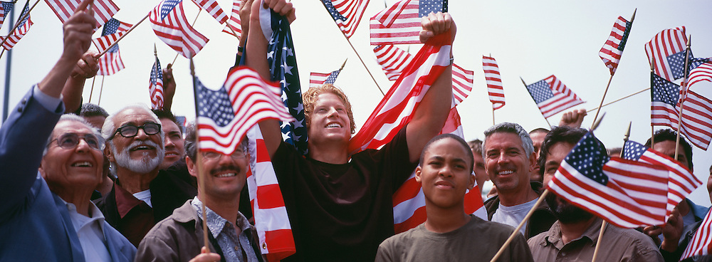 Group of multi-ethnic people with American flags celebrating Independence Day(US)