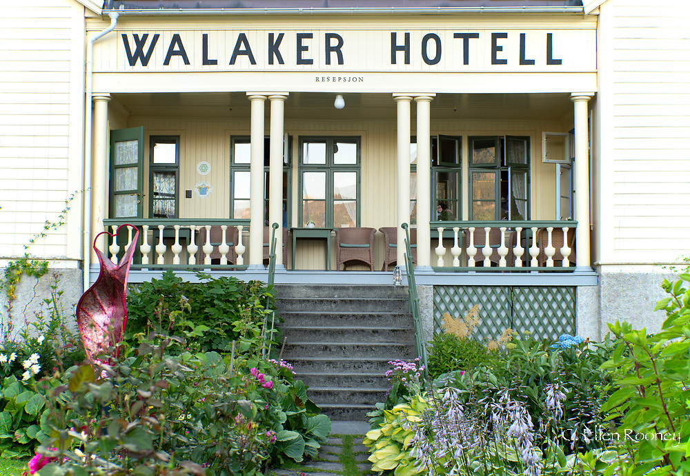 The Walaker Hotell, a traditional hotel and with a beautiful front garden on Lustra Fjord in Solvorn, Norway