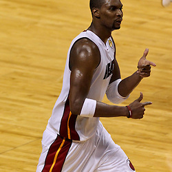 Jun 21, 2012; Miami, FL, USA; Miami Heat power forward Chris Bosh (1) reacts against the Oklahoma City Thunder during the third quarter in game five in the 2012 NBA Finals at the American Airlines Arena. Mandatory Credit: Derick E. Hingle-US PRESSWIRE