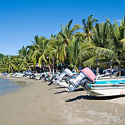 Fishing boats on the beach at Playa Principal at Zihuatanejo, Mexico
