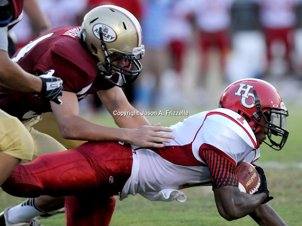 Ashley's Alex Highsmith tackles Hoke County's Brandon McRae Friday August 23, 2013 at Ashley High School. (Jason A. Frizzelle) This collection of images is from the 2013 High School Football in the Cape Fear region.