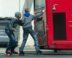 Rollerskating from the back of a bus