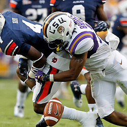 October 22, 2011; Baton Rouge, LA, USA; Auburn Tigers running back Quan Bray (4) fumbles a punt return as he is hit by LSU Tigers cornerback Ron Brooks (13) during the second half at Tiger Stadium. LSU defeated Auburn 45-10. Mandatory Credit: Derick E. Hingle-US PRESSWIRE / © Derick E. Hingle 2011