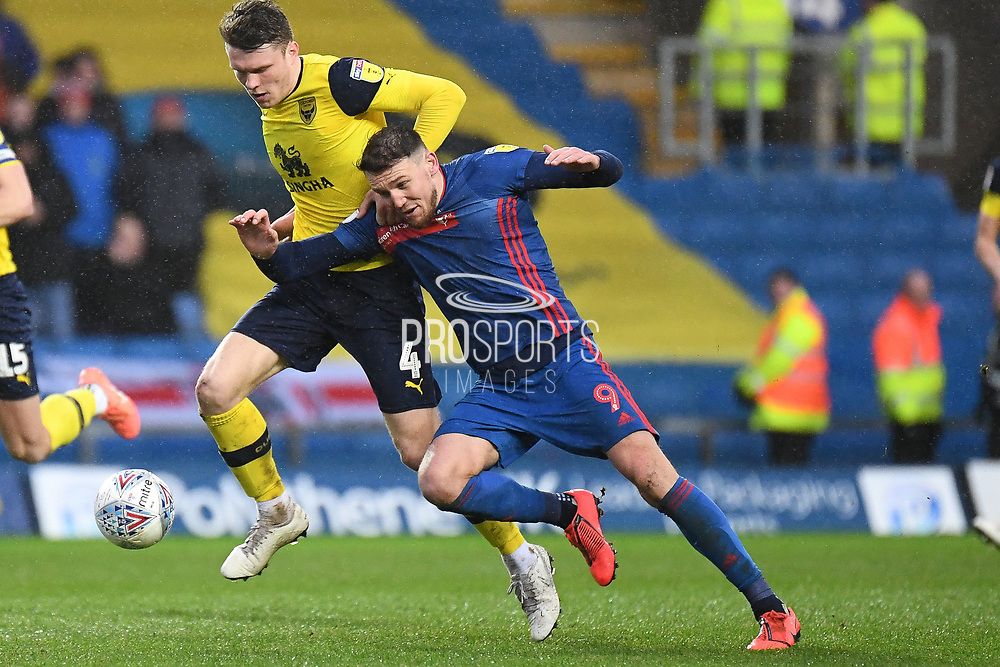 Sunderland forward Charlie Wyke (9)  battles for possession  with Oxford United defender Rob Dickie (4) during the EFL Sky Bet League 1 match between Oxford United and Sunderland at the Kassam Stadium, Oxford, England on 15 February 2020.