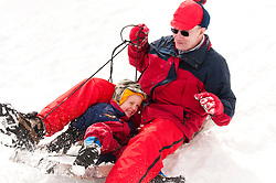 California, Lake Tahoe: Grandpa and grandchild enjoy snow play with sled at North Lake Tahoe Regional Park.  Photo copyright Lee Foster.  Photo # cataho107683