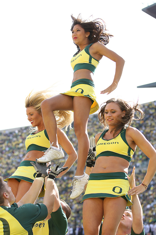 EUGENE, OR - NOVEMBER 6:  Cheerleaders of the Oregon Ducks cheer against the Washington Huskies at Autzen Stadium on November 6, 2010 in Eugene, Oregon. The Ducks defeated the Huskies 53-16.   (Photo by Tom Hauck) Player: