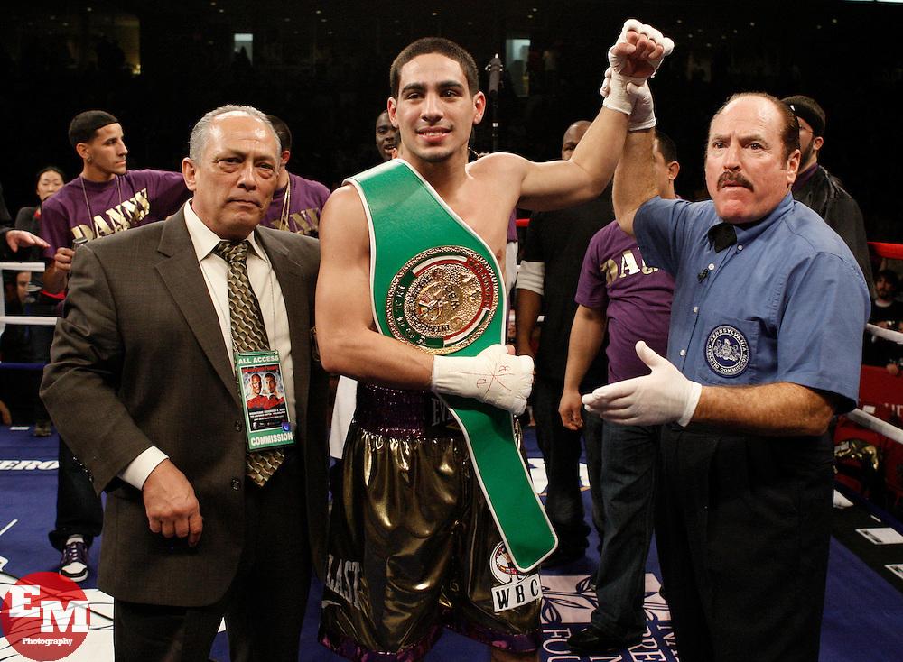 Dec 2, 2009; Philadelphia, PA, USA; Danny Garcia celebrates his KO of Enrique Colin (black trunks) at the Liacouras Center.