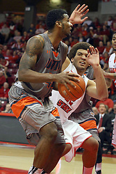 17 December 2014: Reggie Lynch works to figure out the direction Javier Martinez is taking during an NCAA Men's Basketball game between the Skyhawks of University of Tennessee - Martin and the Redbirds of Illinois State at Redbird Arena in Normal Illinois